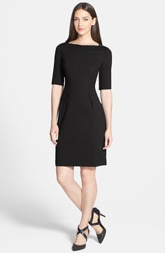 this black knit sheath dress with elbow-length sleeves is the perfect workwear staple and is 50% off right now and still available in every size!