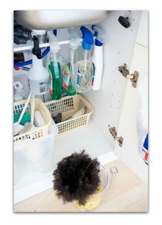Hang your cleaning bottles on a tension rod positioned under the sink. Gets them off the floor so you can still store other essentials under them!