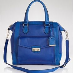 """NWT Cole Haan Zoe Structured Satchel in cobalt GORGEOUS cobalt Cole Haan satchel. Protective wrapping still on handles and hardware. Very roomy with separate compartments on front, back and inside to keep everything organized. Can fit 13"""" MacBook Air. Top handles have 5.5"""" drop and removable, adjustable crossbody strap has 18.5"""" drop. Measures approximately 11.75"""" H x 12.5"""" W x 6.5"""" D. Can take more pictures if requested. Dust bag included. Cole Haan Bags Satchels"""