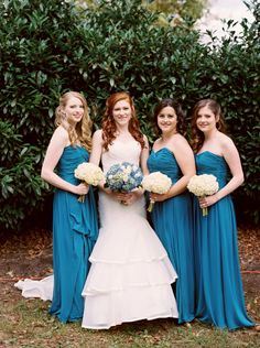 Bridal party. Dresses from White Lace and Promises in Knoxville, TN. Bridesmaid dresses by Dessy in ocean blue. Bride wearing ivory mermaid dress by Essense of Australia.