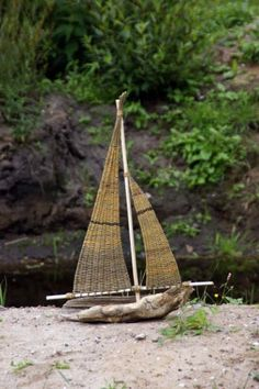 Beautiful model boat made from driftwood and willow weaving