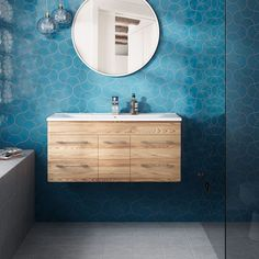 A modern take on traditional Moroccan design, these fan tiles make a serious style statement. Hearth Tiles, Bathroom Fireplace, Cosy Kitchen, Persian Blue, 1920s House, Downstairs Toilet, Wall Fans, Moroccan Design, Bathroom Inspo