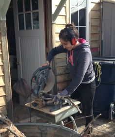 Cynthia ( Mexico ) learning to use the chopsaw.