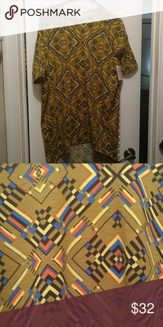 Xxs LuLaRoe Irma, bnwt Multicolored (see picture for pattern); includes a dark gold, orange, yellow, black, and blue; nwt tried on once. Smoke-free, dog-friendly home LuLaRoe Tops Tunics