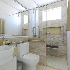 Banheiro com barras de acessibilidade para auxiliar idosos.
