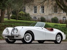 1949 jaguar XK120 roadster. I love this baby.  I love it too.  This was style; you don't see this any more.