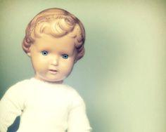 50's German Doll. Checkered Skirt, White Shirt. Green Glass Eyes, Light Brown Painted Hair. Nursery Art. Vintage Toys Series. 1 Photo 8x8. €18,00, via Etsy.