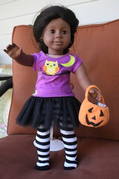 Made my niece a Halloween outfit for her American Girl doll.  Even sewed a pottery barn style treat bucket to go with!