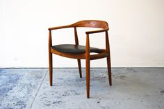 Illum Wikkelso Armchair Solid elm armchair with synthetic leather seat, manufactured by Niels Eilersen, c1960. £ 395 W - 61cm / D - 51cm / H - 74cm