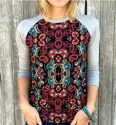 With the Randy T we like to swap the print and solid fabrics between the sleeves and body. Check out the look of this one with the solid grey on the sleeves and a fun colorful print on the body! #lularoerandy #LuLaRoe PC: @lularoeashprobst