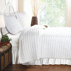 Quilted White Bedding.