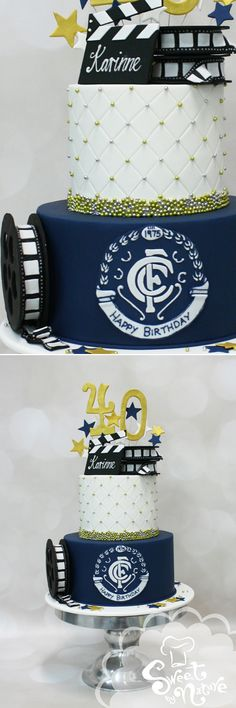 Karinne's 40th birthday cake with all the trimmings!  Her milestone birthday cake was encased in white and navy rolled icing and finished with gold and silver cachous, a Carlton Football Club plaque, and film reels.  The top tier was flourless chocolate mud cake with a milk chocolate buttercream and raspberry swirl filling. The base was coconut mud cake with a coconut buttercream filling.  Happy birthday Karinne! | Made by Sweet by Nature, Melbourne VIC