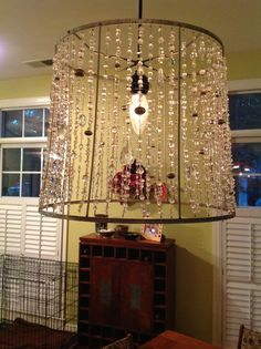 An old lampshade strung with lots of different clear beads, quartz, glass and metal. Makes me happy, happy, happy! Lampshade Chandelier, Lampshade Redo, Brass Lamp, Pendant Lamp, Lamp Shades, Cool Lighting, Lamp Light, Wind Chimes, Chandeliers