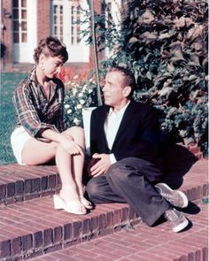 Audrey Hepburn and Humphrey Bogart on the set of Sabrina.... one of my favorite movies ever <3