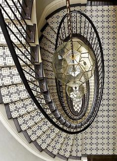 Spiral staircase with geometric carpet