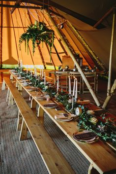 Nordic Pine Table with Bench Seating Wedding marquees and tipi venues for a boho festival outdoor wedding Nordic Wedding, Pagan Wedding, Viking Wedding, Rustic Wedding, Woodland Wedding, Hobbit Wedding, Wedding Bench, Seating Plan Wedding, Tipi Wedding Inspiration
