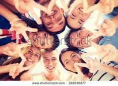 summer, holidays, vacation, happy people concept - group of teenagers looking down and showing finger five gesture by Syda Productions, via ...