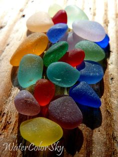 "Sea glass.  ""Red sea glass is the hardest to find. I hear that red is the more rare and valuable, because to make red glass, gold must be added.  Other minerals and metals make other colors."