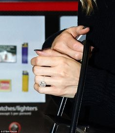 Dazzling: The model was spotted wearing a rather large diamond ring at the travel hub...