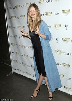 All smiles: She flashed the peace-signs on the red carpet...
