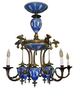 Description: Elegant antique English Victorian bronze gas chandelier circa 1880. This piece features blue and white Wedgwood Jasperware decorated with applied classical figures on the bowls, center vase and five tear-drop shaped hanging fonts. Originally made for gas but has now been electrified. A truly rare and unique piece!