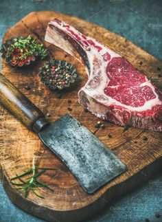 aged raw beef rib eye steak Dry aged raw beef rib eye steak with bone butcher meat chopping knife and spices in bowls on rustic wooden board over grey concrete background selective focus Churros, Carne Madurada, Best Chefs Knife, Realistic Cakes, Meat Restaurant, Meat Steak, Good Food, Yummy Food, Beef Ribs