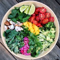 """Sunny day rainbow salad bowl! Mix of baby kale, spinach, chioggia beets, mangos, cilantro,…"""