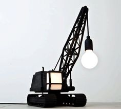 Crane inspired lamp. A really cute small version of the crane lifting a light bulb which in turn provides the light for the lamp.