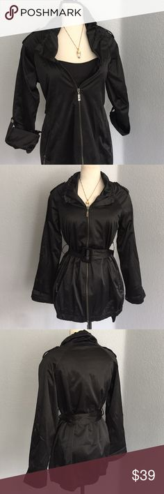New blk raincoat This beautiful fashionable jacket never been worn in perfect condition really clean... Size medium Jackie can be worn with a belt or without a belt long sleeve short sleeve... You will get so many compliments on this adorable jacket Nordstroms Jackets & Coats Utility Jackets
