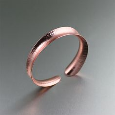Copper Anniversary Gifts' Chased Anticlastic Copper Bangle Bracelet is the perfect elegant 7th anniversary gift for her.  According to tradition, you should mark your 7th wedding anniversary with a gift made of copper and this copper bracelet is perfect.