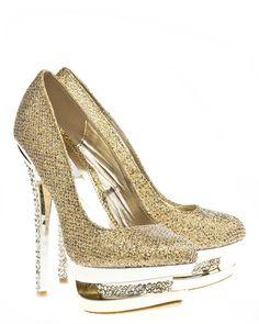 Glittrande heels perfekta för party.Skorna är täckta med guldglitter. De höga klackarna och platåsulan har infällda små glittrande stenar. #metallic #highheals #heals #golden #shoes #skor