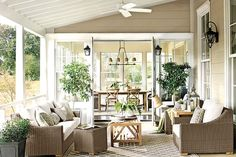 Keep traffic flowing through your porch by facing a pair of chairs toward your sofa. A narrow coffee table will allow guests to walk through the space to the outdoors.