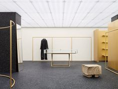 To furnish this Acne store, Lamb created a series of bronze furniture pieces, including a desk, benches and stools