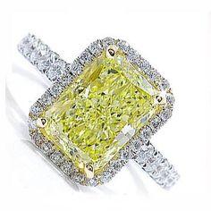 Unique Wedding Rings - Shown: Canary Diamond Ring - http://www.cleverweddingideas.com  (05.07.14)
