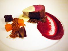 Beef eye fillet on braised beef cheek with beetroot puree, carrot and beetroot cubes, cauliflower crumble and blue cheese sauce
