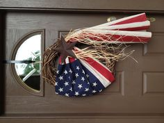 An old American flag, grapevine wreath, raffeta, and a star. Memorial Day wreath and July wreath.