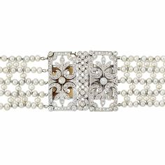 Belle Epoque Multistrand Pearl, Platinum and Diamond Choker Necklace  The pearl mesh choker accented by two delicate openwork fancy-shaped diamond-set plaques, set with small old European and rose-cut diamonds, with French import mark, circa 1910