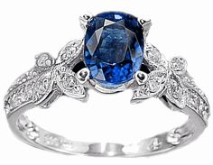 Pretty Sapphire Ring. beautiful color and side decorations~ mindy