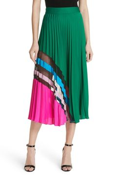An asymmetrical print and fine accordion pleating energize a stretch-silk midi skirt with a figure-defining banded waist.
