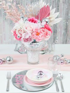 This romantic pink disco themed table setting is one of four designs that are perfect for a wedding or NYE party. Get the details on this and the other three DIY disco-themed table setting ideas now at fernandmaple.com!