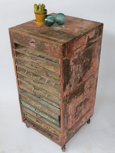 Jewelry flat file? Etsy listing at https://www.etsy.com/listing/178682021/odd-distressed-pink-wooden-rolling