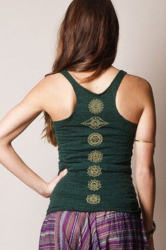 Celebrate the 7 chakras with this must-have tank! In ancient Indian mythology, and even today, chakras are considered to be the most important energy spots in the body. Printed down the spine with sop