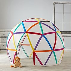 Shop Geodome Playhouse.  We bet your kids have never played inside of a playhouse this roomy (not to mention geometric).  It features lots of bright colors and plenty of space for their best friends.