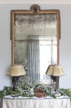 antique mirror with fresh pines