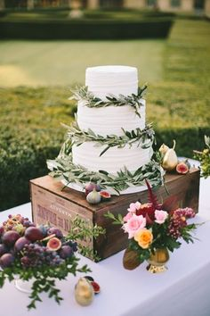 White wedding cake decorated with olive leaves, Lavender & Rose