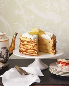Meyer Lemon Crepe Cake - Used in the curd and the candied topping, Meyer lemons subtly elevate this confection. The candied lemons, the crepes, and the filling can all be prepared in advance and assembled just before serving.