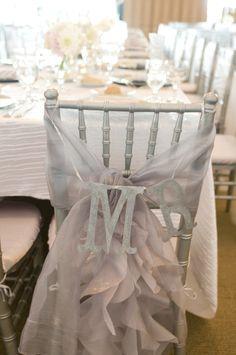 silver tulle monogram chair back white wedding reception
