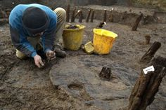 Excavation of Bronze Age Wheel at Must Farm one meter in diameter with hub clearly visible. http://www.visiontimes.com/2016/02/22/the-best-preserved-bronze-age-wheel-in-britain-unearthed.html