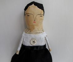 Miracle - a mixed media folk art doll.  Cathy Cullis/London/etsy. One of a series. Miracle 'wears' her name in paper - she is simply lovely in black and white with a vintage pearl buttons sewn to her bodice.... and yes she does believe in miracles, don't you know.....    - she is created using a variety of handmade techniques including papier mache and hand stitch. Her paper is carefully selected from old novels. She has hand painted features and a hand drawn face.     My dolls are inspired…