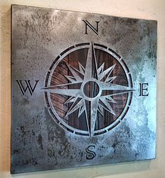 This compass rose comes in two sizes; and It's available with dark stain or natural reclaimed wood. Ships via UPS Ground in approx. weeks as each piece is custom made to order. metal art Compass Rose - wall art - metal art - reclaimed wood and aged steel Metal Projects, Welding Projects, Art Projects, Welding Ideas, Metal Crafts, Welding Crafts, Project Ideas, Instalation Art, Rose Wall